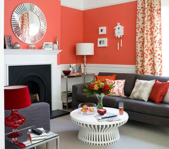 Căn phòng sang trọng với màu màu đỏ pha cam kết hợp bộ sofa đen xám